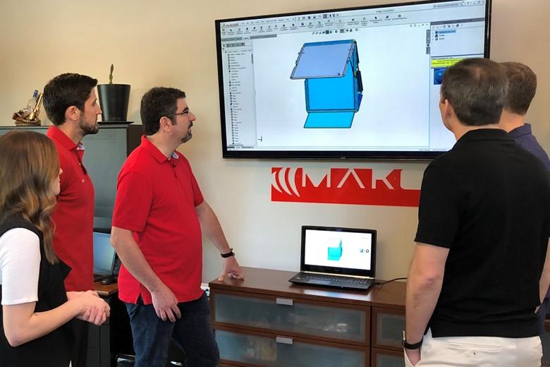 Mako Design team discussing prototypes.